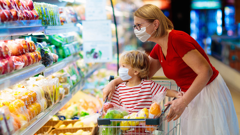 Mother and child grocery shopping