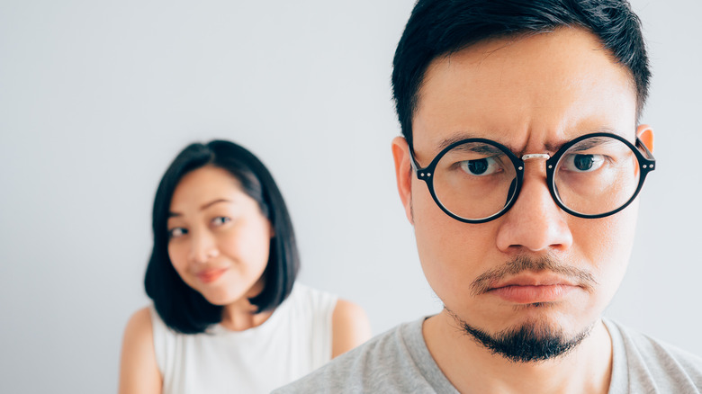 Annoyed man and unsure woman