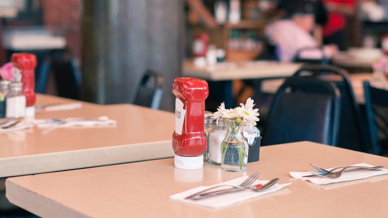 Ketchup bottle on a restaurant table