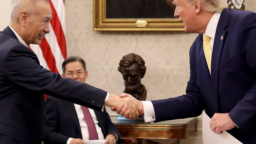 Donald Trump shaking hands with visiting dignitary