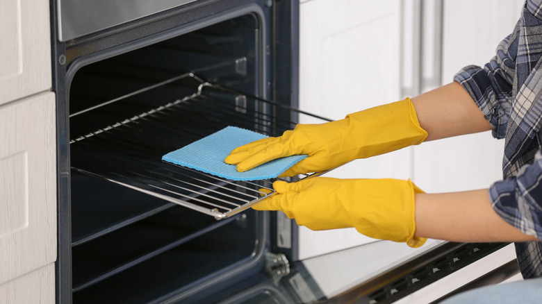 Woman cleaning oven racks