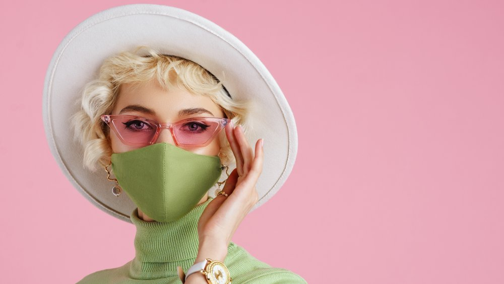 Woman wearing glasses with a face mask