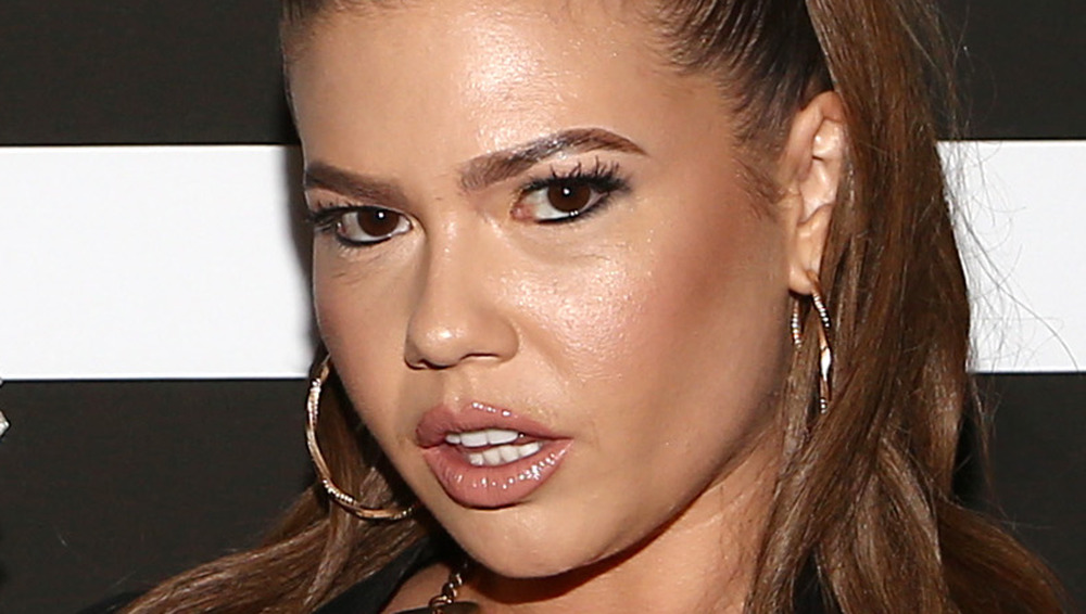 Chanel West Coast with mouth slightly open and hoop earrings