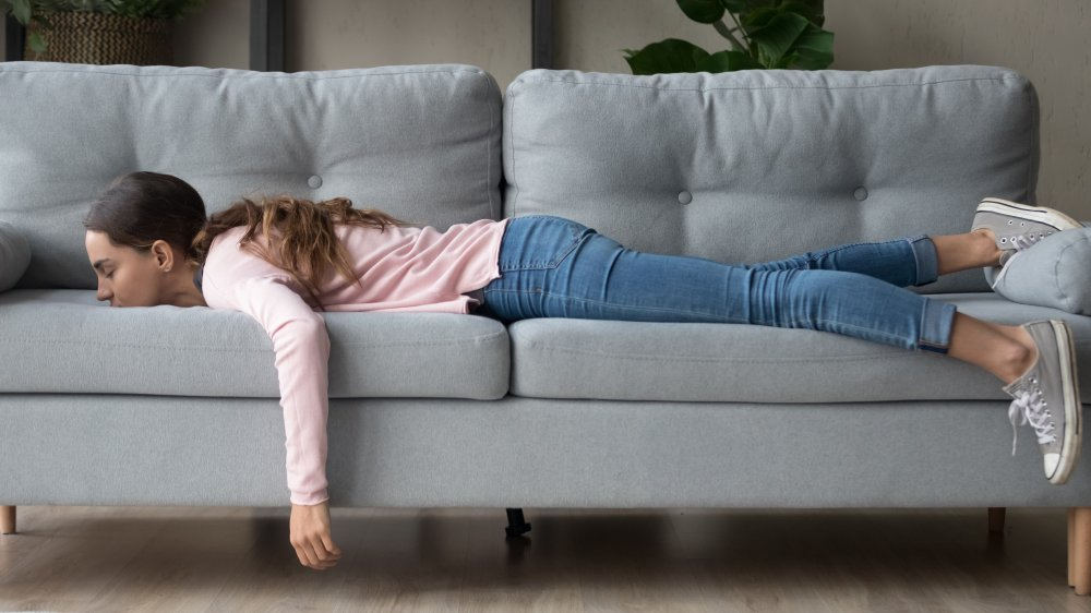 Woman napping on her couch