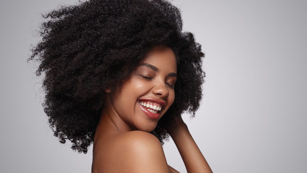 Woman with curly hair smiling