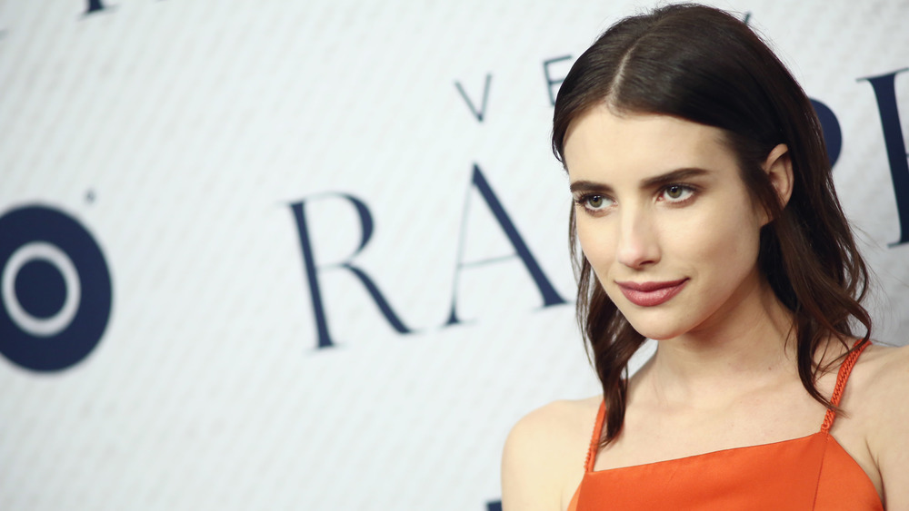 Emma Roberts wears orange on red carpet