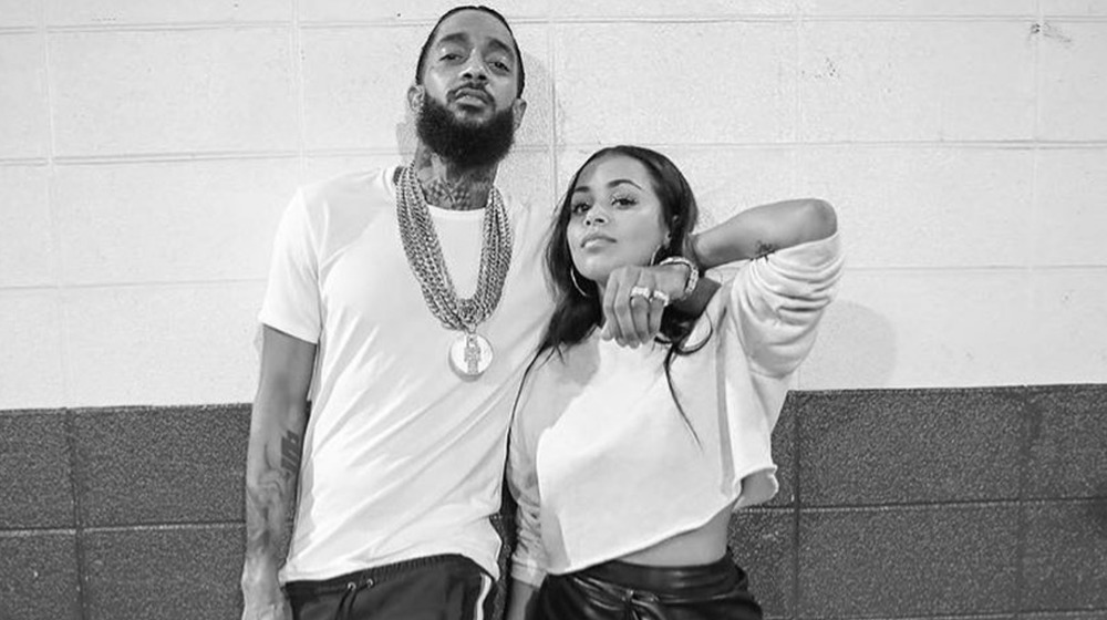 Lauren London posing with Hussle