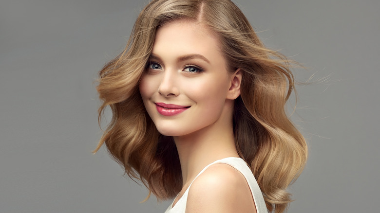 blonde woman with mid-length full hairstyle