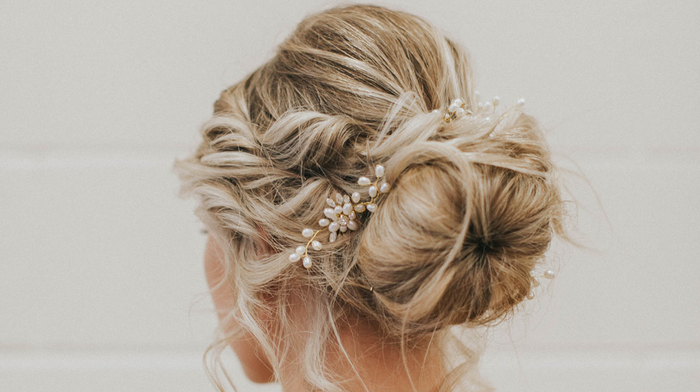Back view of a chignon with pearl accessory