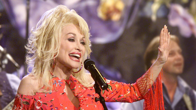 Dolly Parton performing on a late night show in 2002