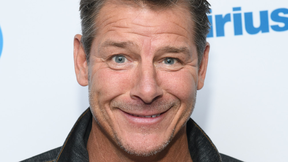 Ty Pennington smiling with facial scruff