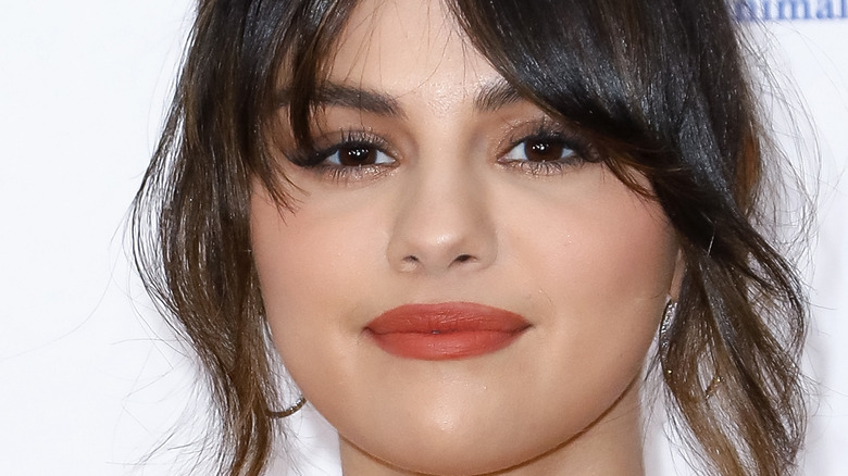 Selena Gomez grins with curtain bangs