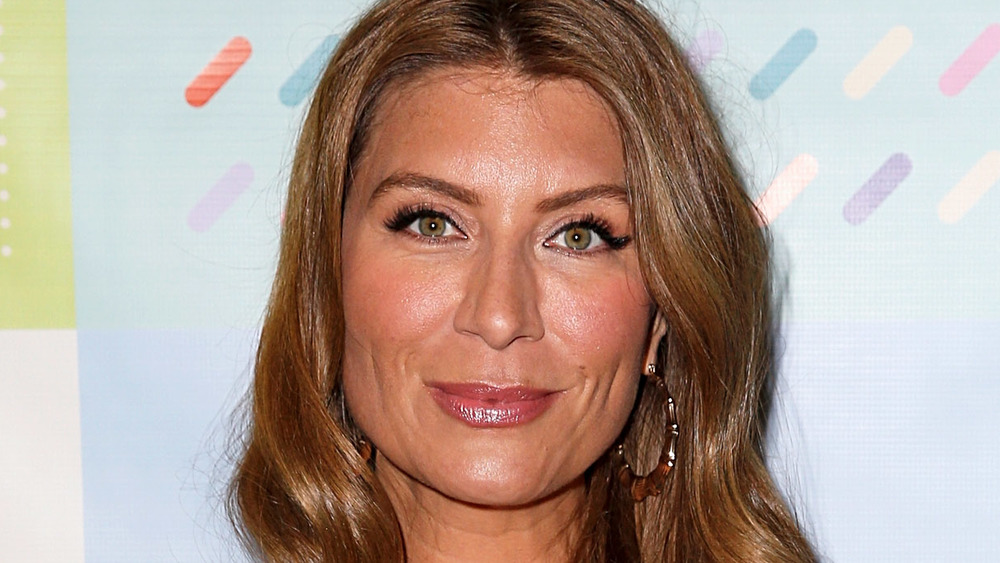 Genevieve Gorder smiling at event