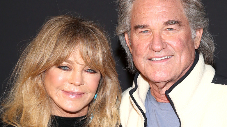 Goldie Hawn posing with Kurt Russell