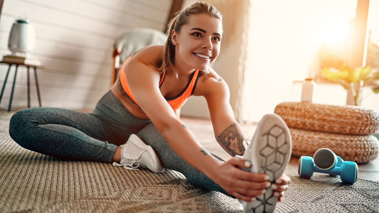 Woman in workout clothes stretching