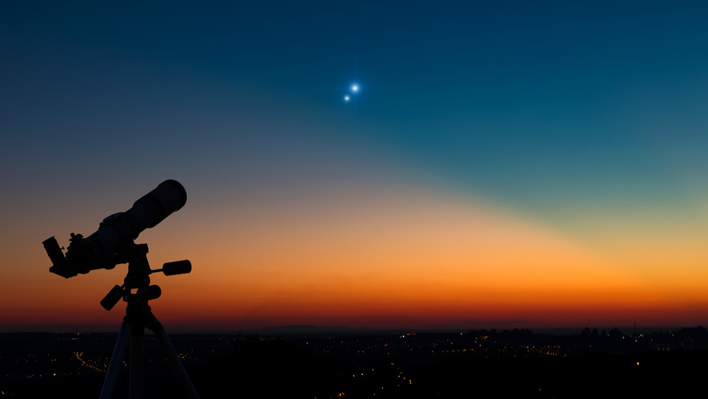 A telescope pointed at a star in the dusk sky