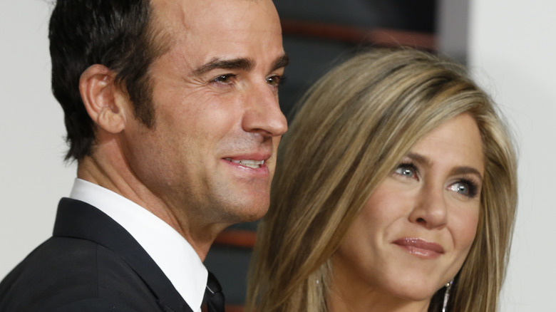 Jennifer Aniston and Justin Theroux smile on red carpet