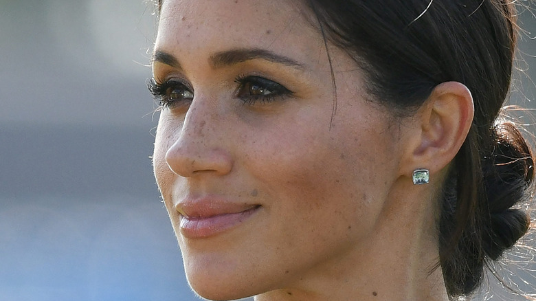 Meghan Markle in profile grinning