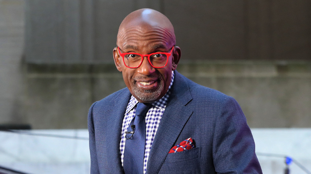 Al Roker on television wearing red glasses