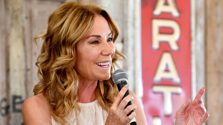 Kathie Lee Gifford speaking into a microphone