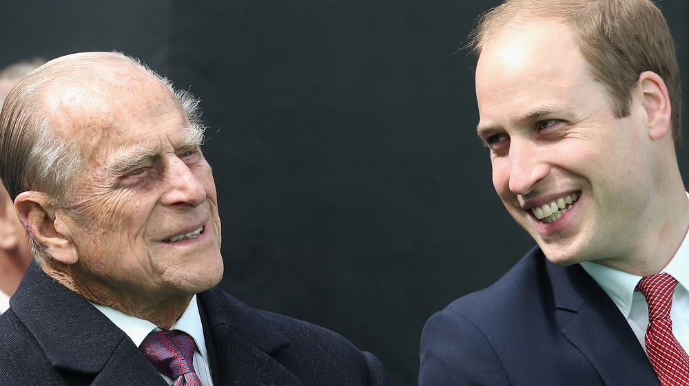 Prince William and Prince Philip smiling