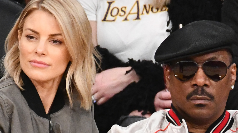 Eddie Murphy with Paige Butcher at game