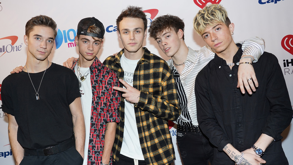 Why Don't We poses together including Daniel Seavey