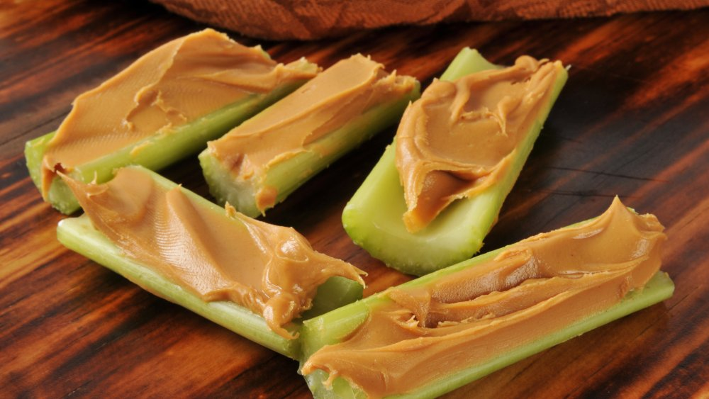Celery sticks filled with peanut butter on a table