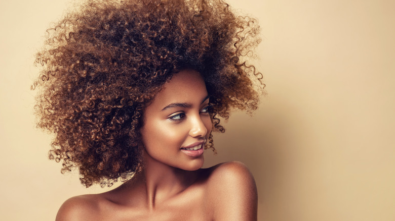 Beautiful natural hair on woman looking to the side