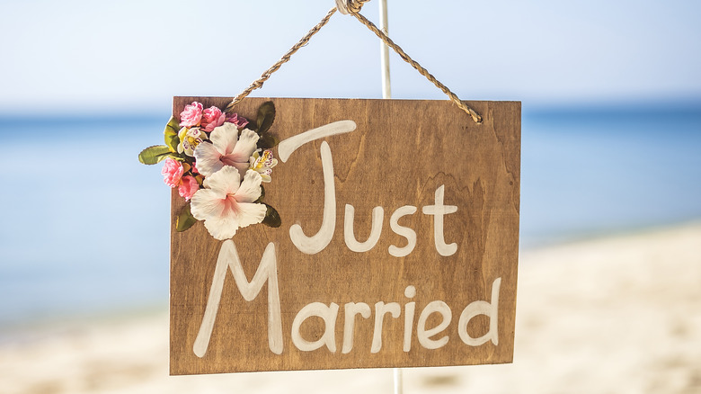 """""""Just Married"""" on a beach"""