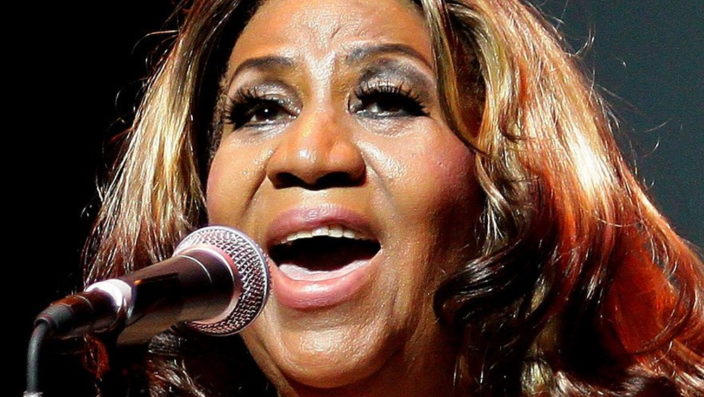 Aretha Franklin singing at a concert