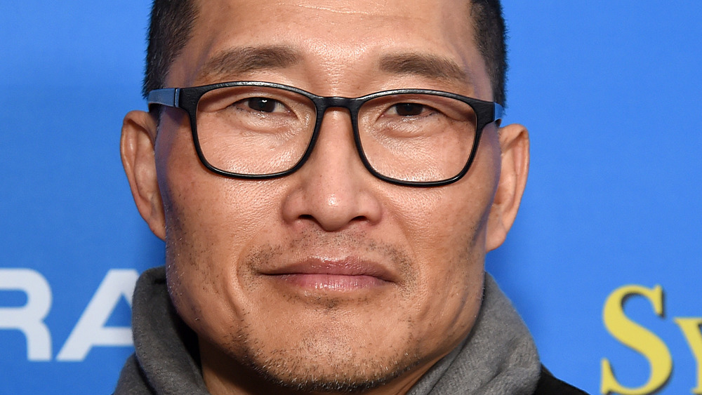 Actor Daniel Dae Kim grinning with glasses