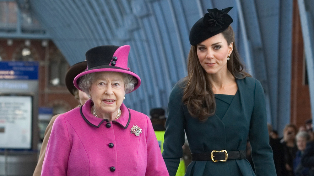 Queen Elizabeth walking with Kate Middleton