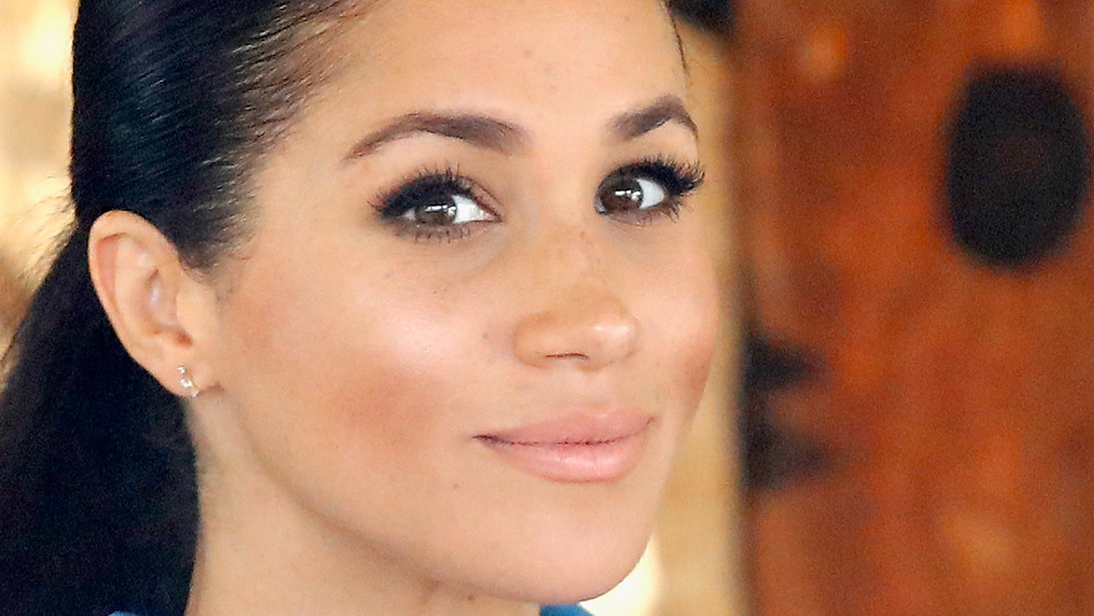 Meghan Markle poses during an appearance