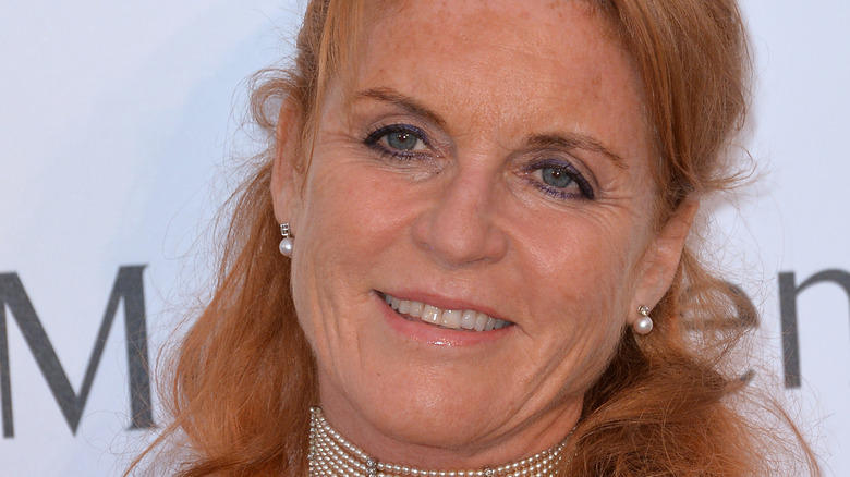 Sarah Ferguson smiles and wears red