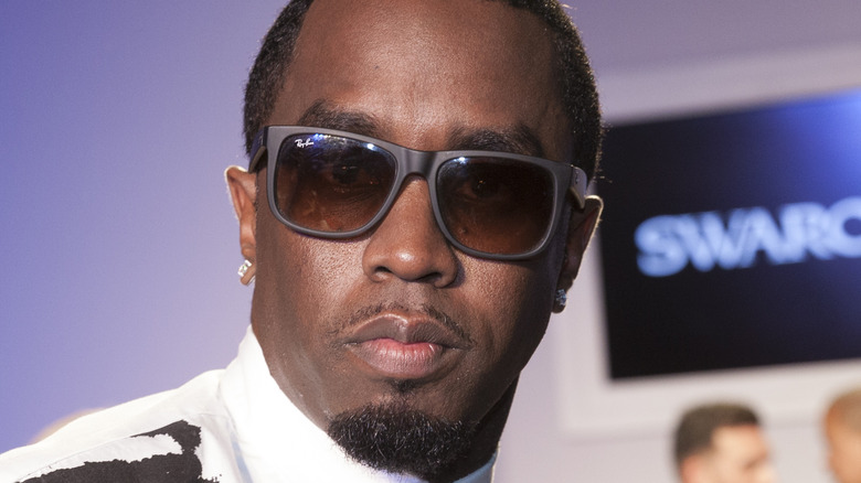 Sean Diddy Combs in sunglasses posing