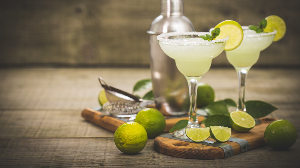 Margaritas garnished with lime