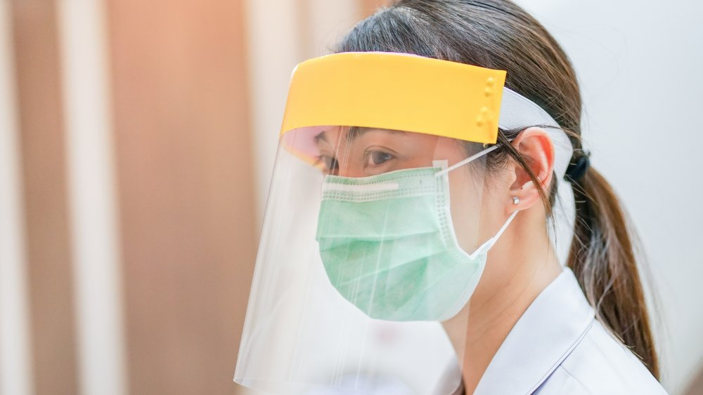 Face shield as used by a medical worker