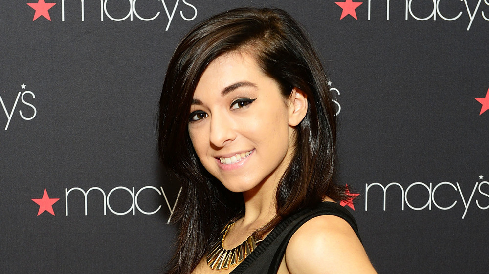 Christina Grimmie on a red carpet, smiling