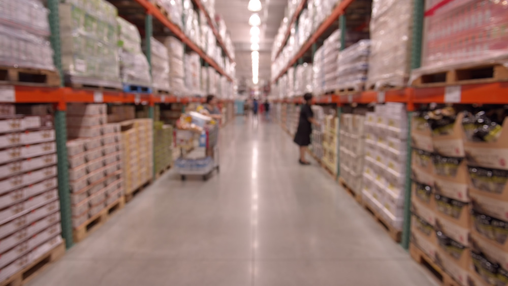 A woman amongst the towering Costco shelves